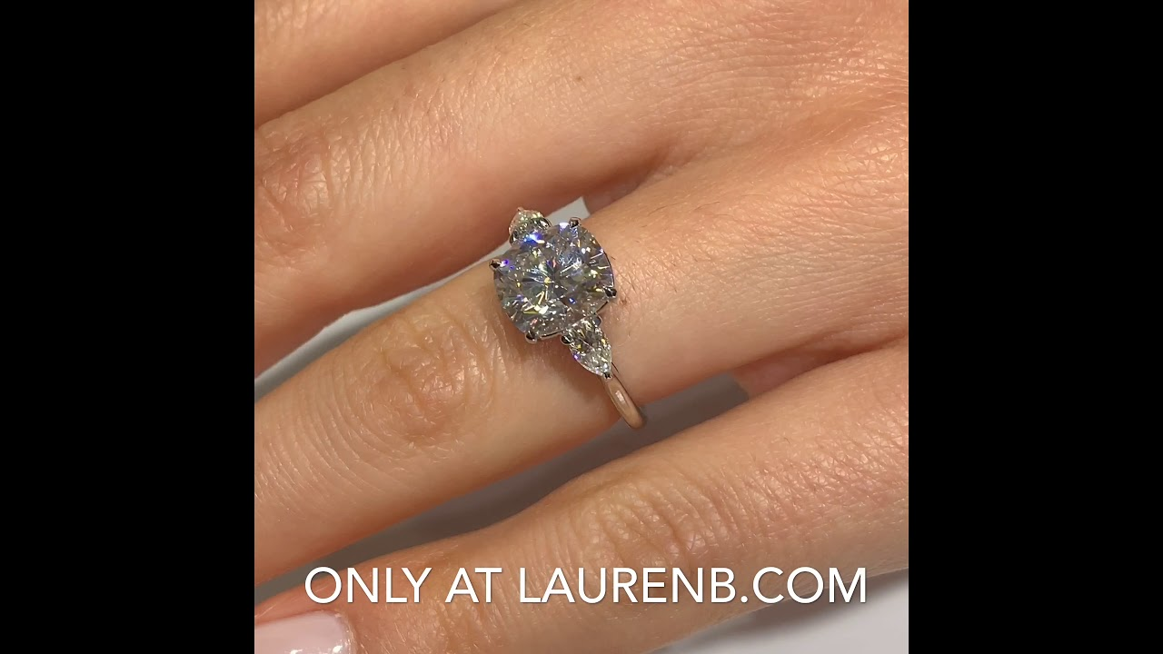 Cushion Moissanite Three-Stone Engagement Ring