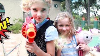 kid superheroes with the brightlings versus the the evil superhero in a real life nerf war