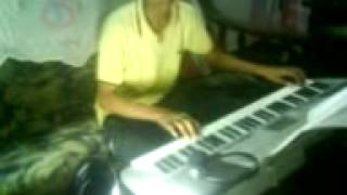 Vennila Chandana Kinnam playing in keyboard.