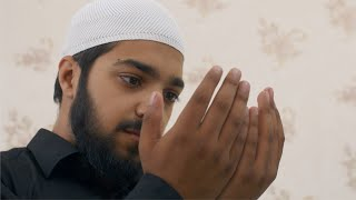 Muslim guy praying for blessings from Allah in the morning - traditional wear