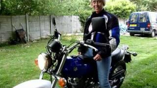 Yvette riding her suzuki van van