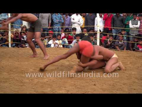 Young Indian boys wrestling Kushti dangal in outskirts of Delhi