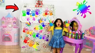 Playhouse with colorful hands paint