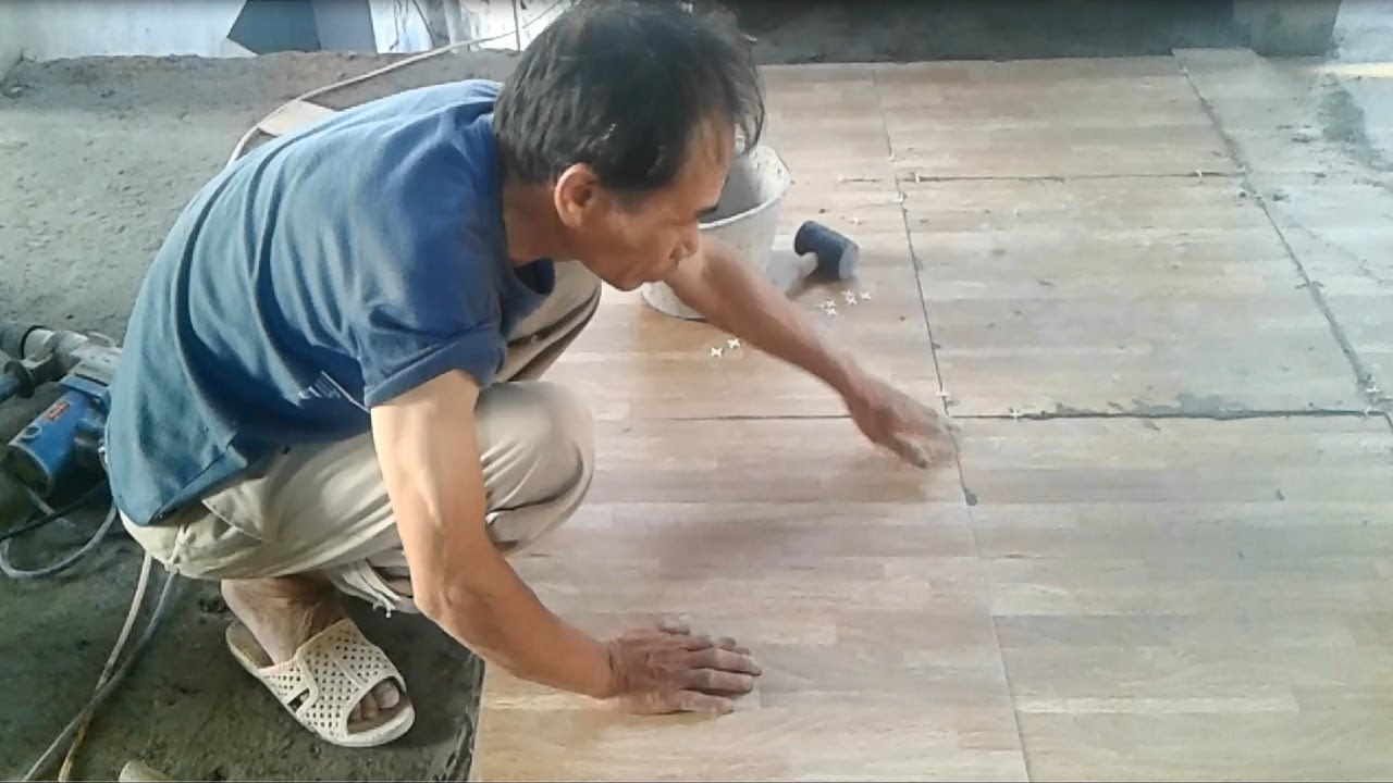 Installation of ceramic tiles on the largest floor house installation of ceramic tiles on the largest floor house construction ceramic tile on floor dailygadgetfo Images