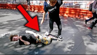 SKATEBOARDER TRIED TO JUMP OVER ME...*OUCH*
