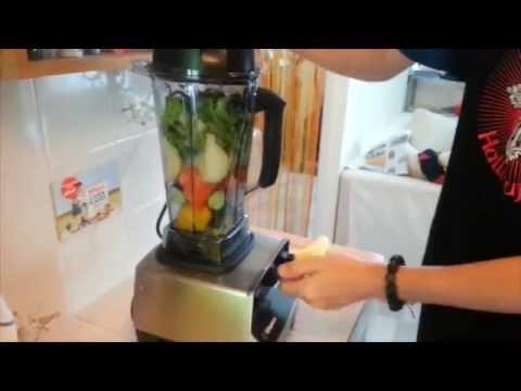 The VitaMix blender blending some chunky vegetables