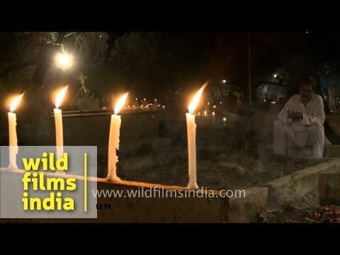 Candlelit graves of Nizamuddin graveyard on the eve of Shab-e-barat