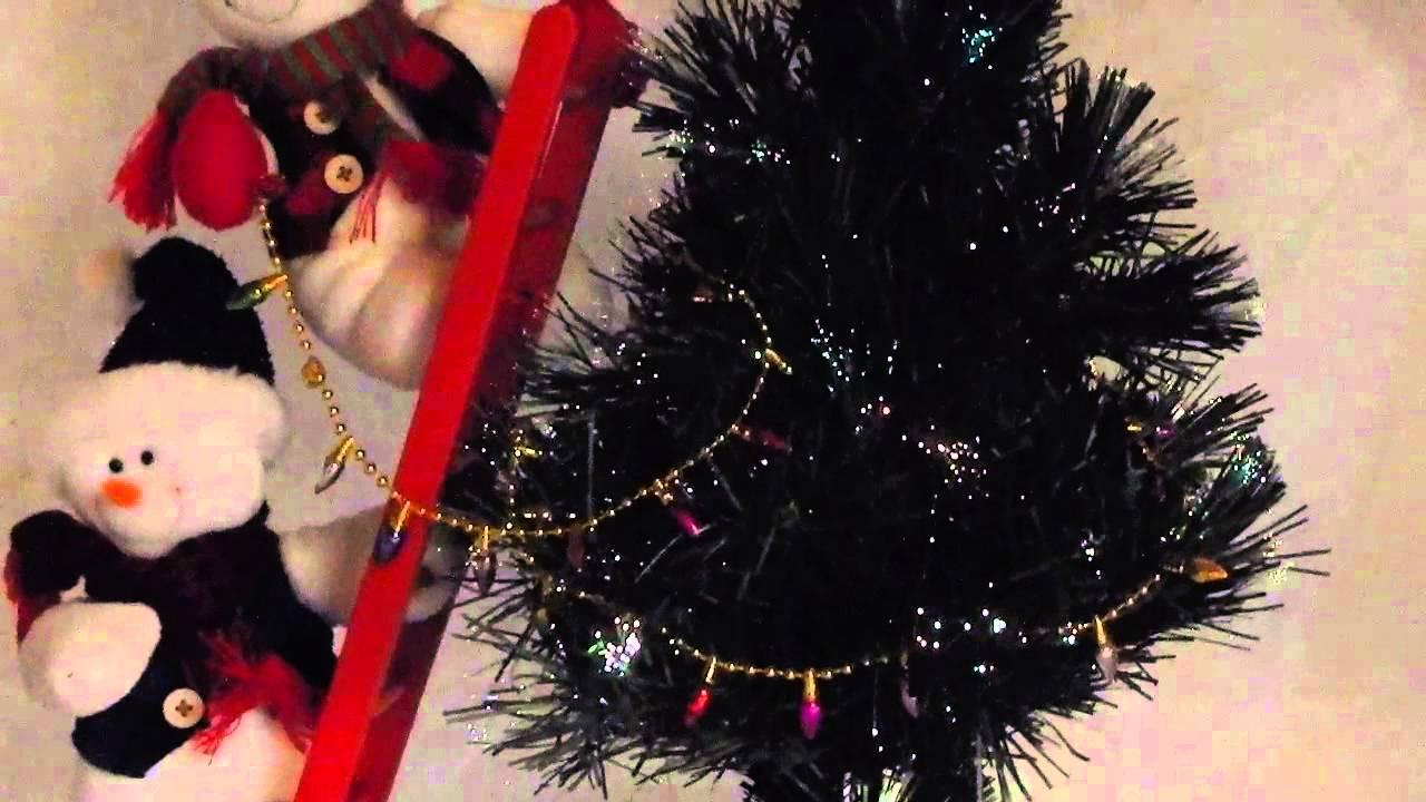 Fiber Optic Christmas Tree With Bears Decorating It