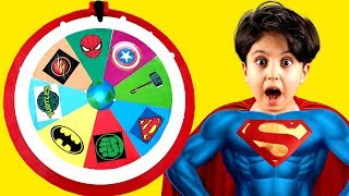 Children play with a superhero wheel