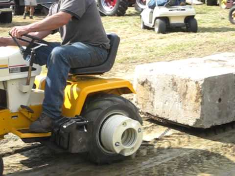 Cub Cadet Pulling Stone Boat 6000 Pounds Many Times Red