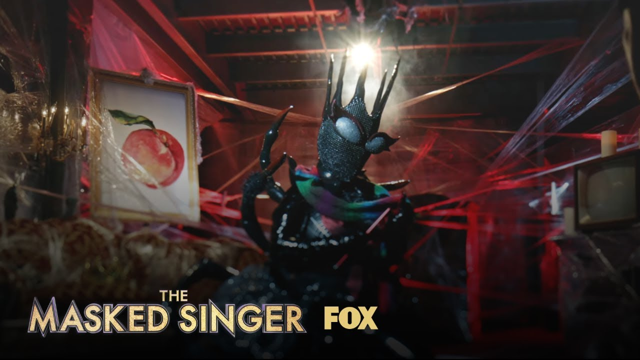 The Masked Singer's Black Widow on her badonkadonk ...