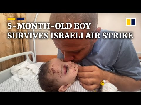 'He's all that's left': Gaza father grasps infant son after Israeli air strike wipes out family
