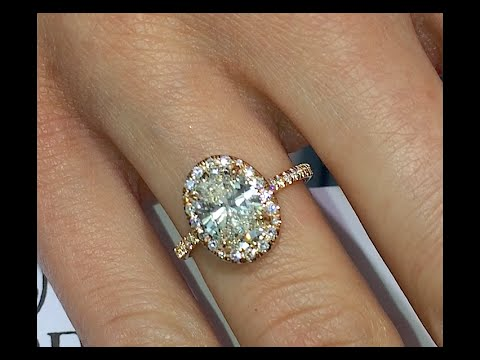 Oval Cut Diamond Halo Engagement Ring in Rose Gold