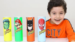 Yusuf pretend play with Pringles Superhero