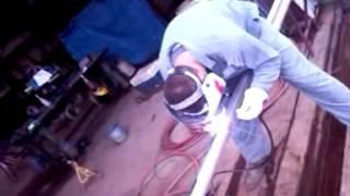 Bret Fisher welding