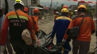 Crews in Indonesia recover hundreds of bodies from rubble of earthquake, tsunami