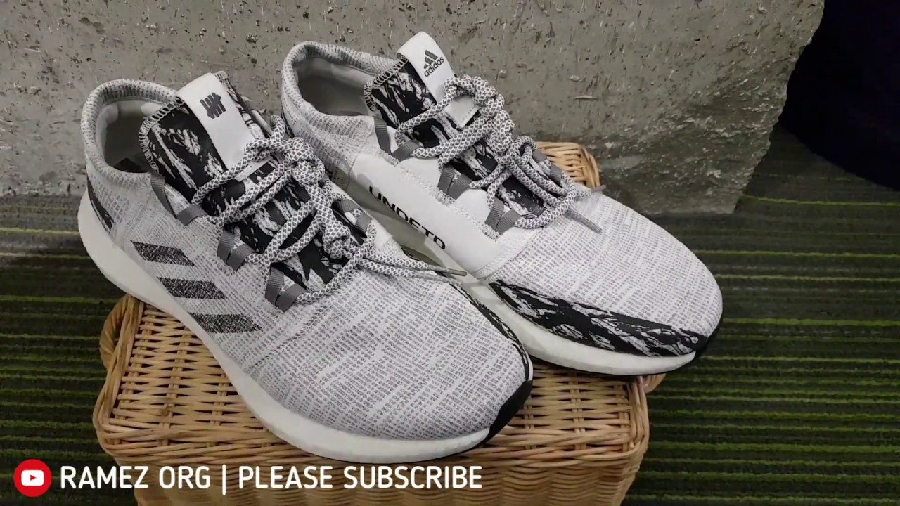 tempo metereologico attaccamento residuo  ADIDAS x UNDEFEATED PUREBOOST RBL CBLACK SHOES COLLABORATION EDITION -  YouTube