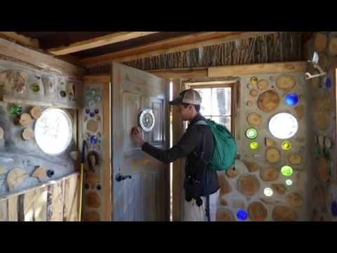 Cord wood house camera shutter door window
