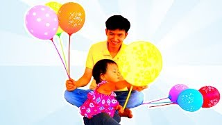 Baby Nora Playing with Coloured Balloons