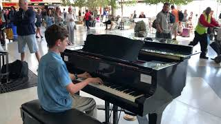 "13 year-old volunteer pianist, performs ""believer"" by imagine dragons at the charlotte douglas international airport in charlotte, nc."