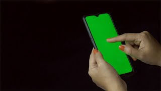 Closeup of an Indian female using her smartphone with green mock-up screen