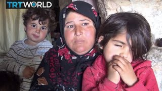 The War in Syria: Displaced Syrians shelter from bombs in caves