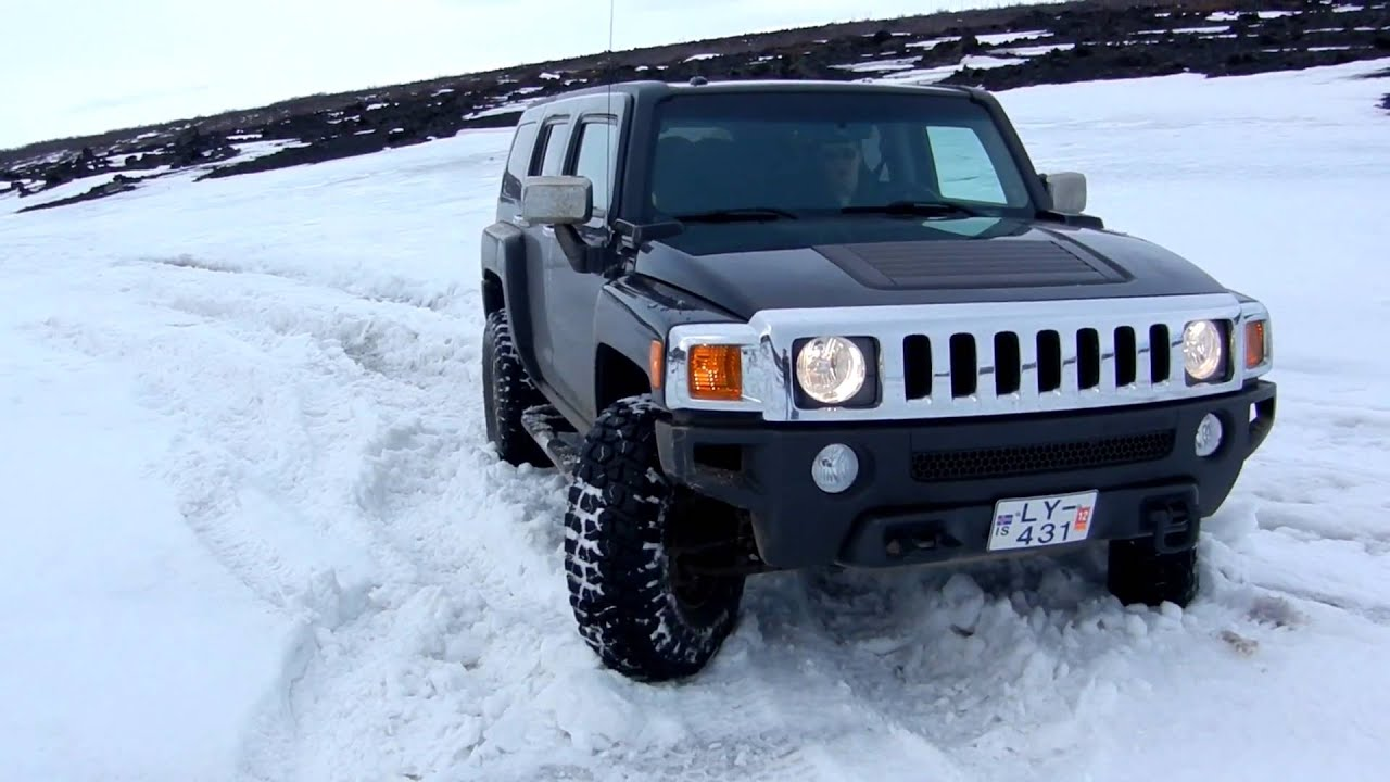 Boppos driving a Hummer in Iceland