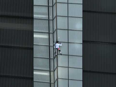 French (Alain Robert) Spiderman' climbs Heron Tower in the City of London 2018