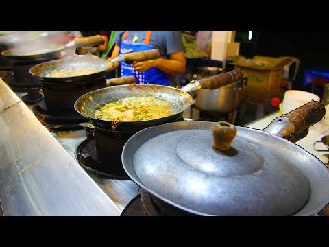 Thai Orchids & Street Food at a Fair in Thailand. Street Food Shopping at a Thai Market