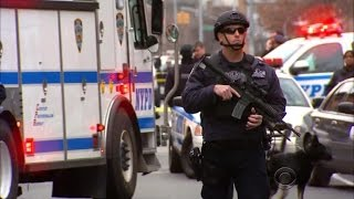 NYPD officers killed in patrol car shooting