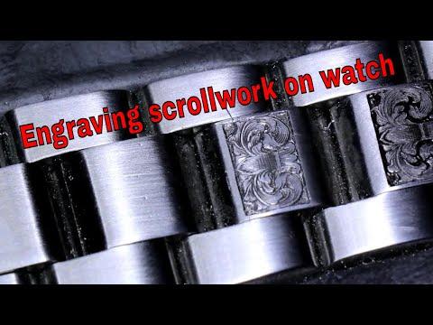Engraving scrollwork on watch bracelet by Reinis Stripnieks