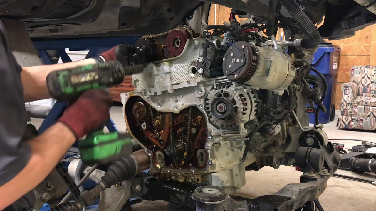 step by step 2 4 ecotec timing chain replacement [ 1280 x 720 Pixel ]