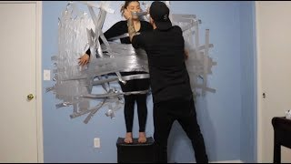 DUCK TAPE CHALLENGE!! (BOYFRIEND TAPES GIRLFRIEND TO THE WALL!! )