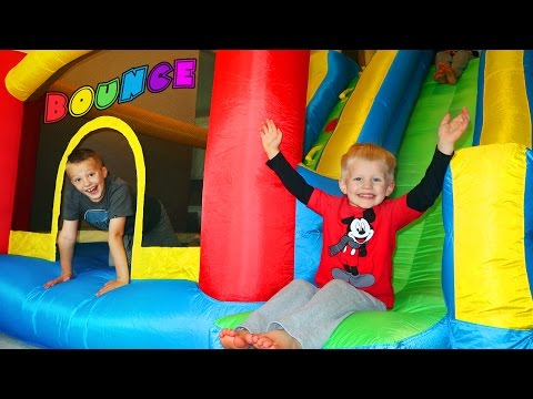 GIANT BOUNCER STUCK IN OUR HOUSE!  Little Tikes GIANT SLIDE Inflatable Bouncer Kids Toy Playtime