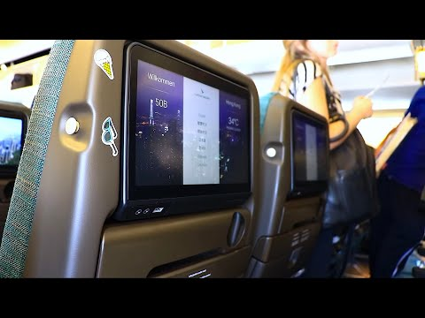 BRAND NEW 3-4-3 CONFIG! Cathay Pacific Boeing 777-300ER Economy Review   Rome - Hong Kong CX292