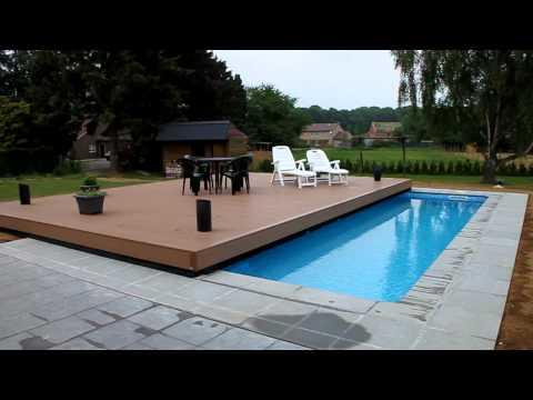 piscine sous une terrasse. Black Bedroom Furniture Sets. Home Design Ideas