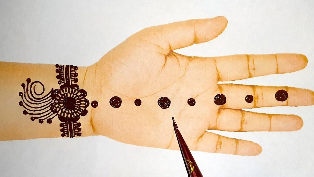 easy hand mehndi design-Arabic gol tikki mehndi design special mehndi design