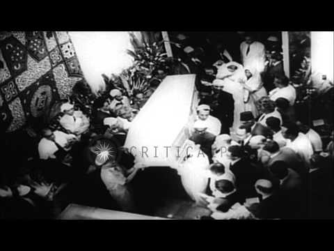 People mourn the death of Ramon Magsaysay and Aga Khan III. HD Stock Footage