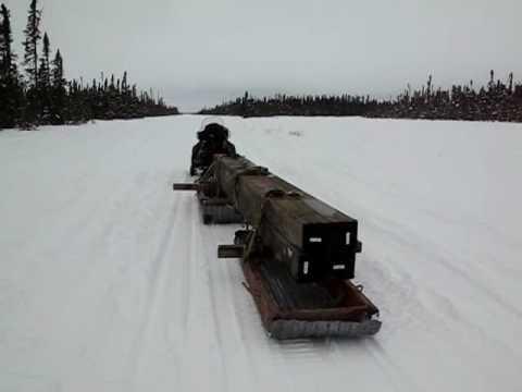 Snowmobile Freight Hauling In Alaska