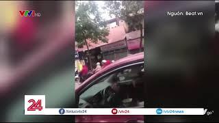 Nữ tài xế vừa lái ô tô, vừa ăn | VTV24