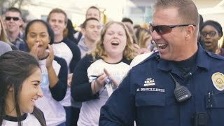 Massive mob overwhelms school's favorite police officer! thumbnail