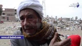 بالفيديو والصور .. تلال القمامة تحاصر مدينة ' أوسيم ' ..والأهالى يتضررون