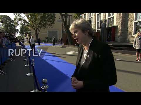 Estonia: 'I want them to stay,' PM May says of EU citizens amid heckling in Tallinn