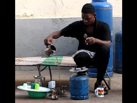 Guinea man in Togo West Africa Shares his Chinese Tea With Me