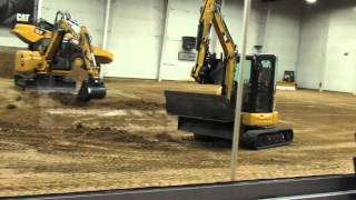 Video still for The Cat 304 5E2 XTC mini hydraulic excavator demonstrated