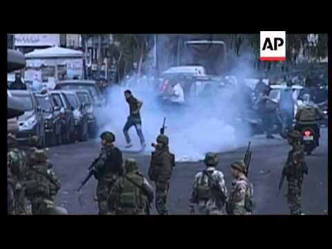 +4:3 Tear gas fired as protests over Hezbollah candidate turn violent