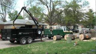 Loading A Large Sweet Gum Tree Trunk With A Grapple Boom Arm
