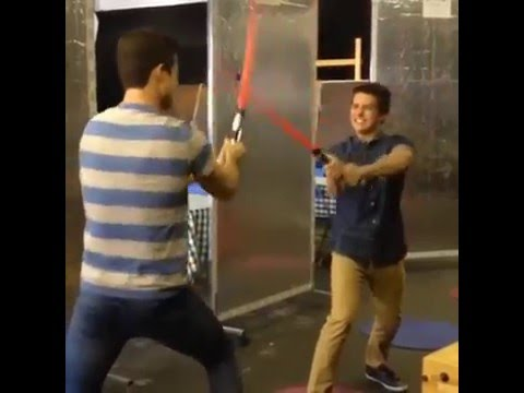 Billy Unger & Spencer Boldman playing with lightsabers
