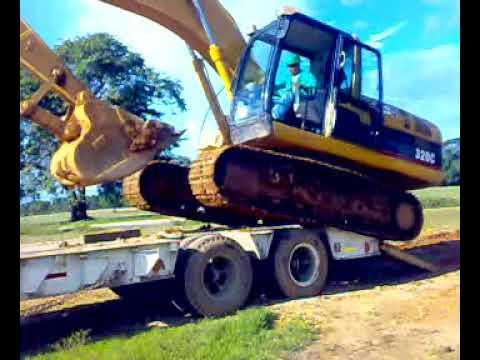 Diferentes Formas De Subir Y Bajar Una Excavadora De Un Camion
