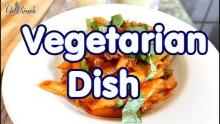 Green vegetables with pasta in tomato sauce vegetarian dish